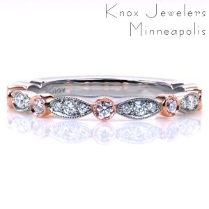 Our Slipper Two Tone band combines texture and color in a beautiful custom update. Warm rose gold is incorporated in an alternating pattern with white gold, and the variety of stone settings adds a unique touch. Hand applied milgrain edging is added for a vintage inspired touch.