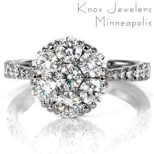 Design 3709 is a vintage inspired beauty featuring seven perfectly matched diamonds cradled in a unique, low setting. Graduated diamonds adorn the band, which tapers elegantly into the center, adding extra sparkle and dimension. The high polish on the band glimmers along with the diamonds.