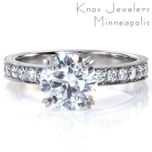 A timeless design with subtle details, Design 3719 delivers a lot of sparkle. A four prong crown is fashioned high to place all the attention on the impressive 1.50 carat round center stone, and the band is set with  micro pavé stones. Milgrain detail is applied by hand to the band and the prongs.