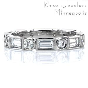 Design 3727 is striking on its own or stacked with other bands. It features alternating bezel set round brilliant diamonds and baguettes of more than 1 carat total weight in an eternity band. Contemporary and geometric, this design is sure to get noticed!