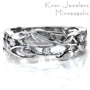 With sparkling diamonds woven into a beautiful leaf and vine design, Design 3728 is no ordinary band. This design works equally well as a wedding band or a stunning right hand ring. The crisp design is accentuated by intricate hand engraving on one of the leaves, adding beautiful texture and dimension.