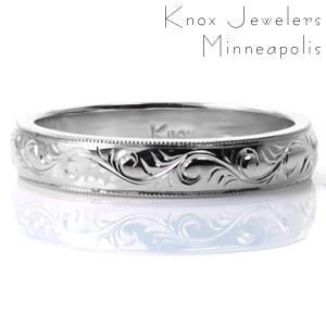 Intricate hand engraving in a delicate scroll pattern adorns this elegant 4mm band. Milgrain detail is hand applied to the bright cut edges, and the all sides of the band are brought to a high polish sheen. This band can be customized easily with a different engraving pattern or a different width.