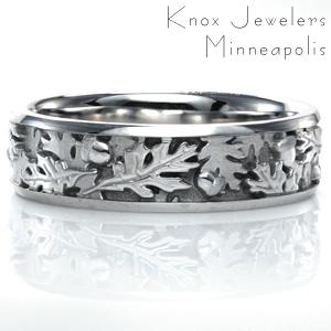 Design 3739 is all about layers and texture. This unique ring features a leaf and acorn motif with hand finished detailing. Some leaves are hand engraved and high polished, while others are sandblasted. Two high polished rails perfectly showcase this intricate design.