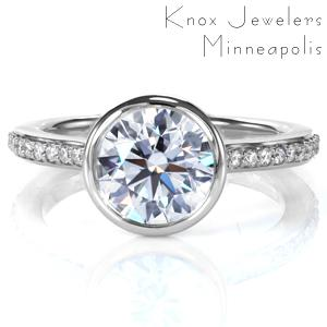 A 1.0 carat diamond is showcased in a full bezel setting in Design 3741. An open gallery under the center setting provides a beautiful, clear view of the stone. A cathedral style band is adorned with beadset diamonds, and the ring is brought to a mirror like high polish finish, completing this modern ring.