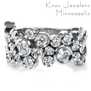 Design 3751 is truly a statement piece! Featuring 3.41 carats of dazzling diamonds and measuring 12mm wide, this ring sparkles from every angle. Multiple sizes of round brilliant diamonds are bezel set and arranged in a random pattern of sparkly bubbles. The band tapers at the back for comfort.