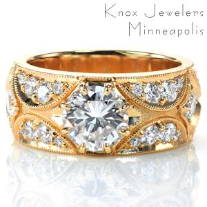 Design 3764 features a 1.0 carat round center stone set within a delicate eight prong setting. The design is accentuated with micro pavé diamonds that are bead set by hand within antique inspired crescent shapes. The design is framed with milgrain detail, adding to the vintage inspired appeal.