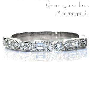 Isabella is a striking, art deco inspired creation perfect worn alone, alongside an engagement ring, or as part of a stack. Baguettes and round brilliant diamonds provide sparkle and hand-applied milgrain detail adds vintage flair and texture. This design is completed with high polished sides.