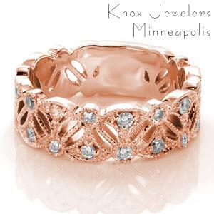 Rose gold wedding ring in Anaheim with elegant pierced pattern and diamonds.