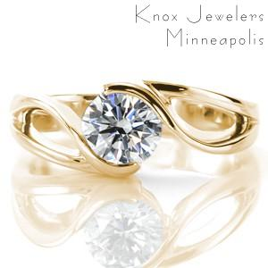Unique engagement rings in Kansas City with round brilliant diamond and yellow gold setting.