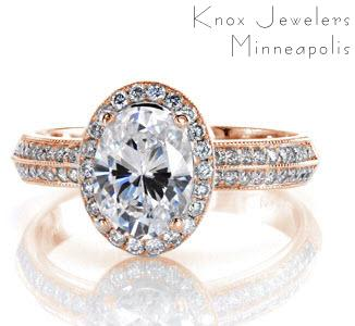 Denver rose gold halo engagement ring with oval center stone and a double row diamond band.