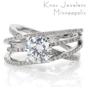 Forth Worth wide band engagement ring with round brilliant center stone and white gold setting.