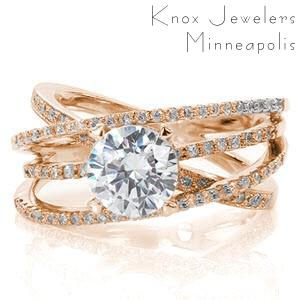 Rose gold engagement ring in Rochester with four overlapping diamond bands and round center stone.